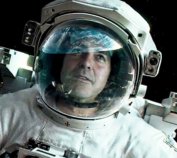 George Clooney in Gravity, photo copyright Warner Bros. Pictures