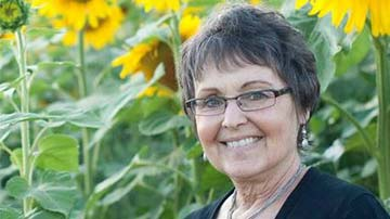 Babbette Jaquish's husband Don planted 4 miles of sunflowers in memory of her.