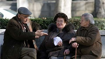 Group of elderly people talking