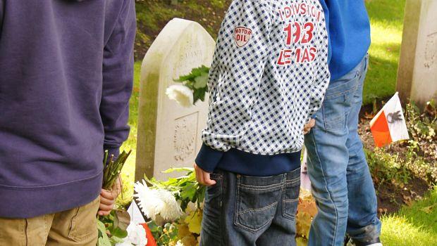 Children at grave