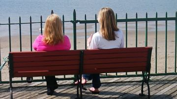 women sitting on bench
